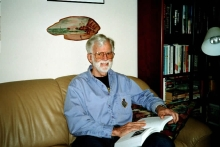 Charles reading in his office